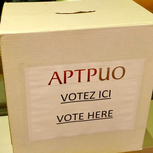 "APTPUO Ballot Box with ""Vote Here"" written on front."